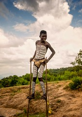 Banna Stiltwalker (Rod Waddington) Tags: africa african afrique afrika äthiopien ethiopia ethiopian ethnic ethnicity etiopia ethiopie etiopian outdoor omovalley omo omoriver outdoors banna tribe traditional tribal stilts stiltwalker landscape nature roadside boy people painted body minority