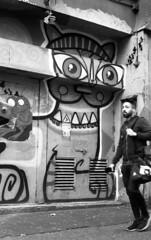 Big Cat (4foot2) Tags: brighton backstreet streetphoto streetshot street streetart streetphotography graffiti graff brightongraffiti brightongraff brightonstreetart cat candidportrate candid reportagephotography reportage analogue film filmphotography 35mmfilm blackandwhite bw mono monochrome rolleiretro rolleiretro400s 400s hc110 kodakhc110 kodak voigtländervitob voigtländer vitob 2019 fourfoottwo 4foot2 4foot2flickr 4foot2photostream