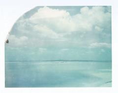 """Polaroid Week Day Three - Distant Island (dreamscapesxx) Tags: polaroid instant daythree expiredfilm peelapart supershooter polaroidweek polaroid669film polavoid snapitseeit island florida lighthouse """"boattour"""" """"tarponspringsfl"""" """"anclotekey"""" """"anclotekeylighthouse"""" tropical sea sky clouds"""