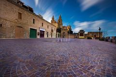 Mellieha in 43 seconds (snowyturner) Tags: mellieha malta foreground longexposure bricks block paving church sky clouds motion square centre