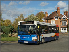 Stagecoach 35184 (Jason 87030) Tags: dennis dart slf pointer red white blue orange estate admirals brownsover slifton road roundabout roadside autumn rugby warks warwickshire service route bus stagecoach midlands wheels lighting sunny