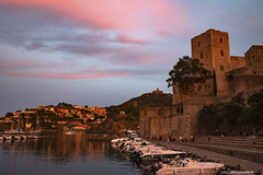collioure harbour sunset (clairescosmos) Tags: nikon d5600 france collioure lafrance sunset sunlight sunsetlight medieval harbour mediterranean southfrance sea seaside bay pier reflection castle chateaux fort boats hills