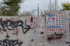 Commissioners Street (Gary Kinsman) Tags: commissionersstreet portlands toronto canada ontario canoneos5dmarkii canon5dmkii industrial postindustrial topographics newtopographics urbanlandscape canon35mmf2 2019 urban skyline wasteground thehearn hearngeneratingstation powerstation richardlhearngeneratingstation decommissioned decay graffiti posters chimney overgrowth advert poster advertising cloud overcast