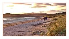Sunset song! (john.methven) Tags: sun sunset beach sand water sea seaside couple walkers clouds glow mellow atmospheric