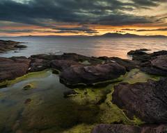 Sunset over the Isla of Arran (Jon_Douglas) Tags: westkilbride scotland unitedkingdom ayrshire isleofarran arran island sunset portencross rockpool seaweed firthofclyde sea water ocean