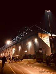 Under the lights (stewardsonjp1) Tags: monochrome people footballground stand crowd game midweek excitement fieldmill mansfield floodlights soccer football
