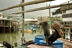boots (Jason Rosenberg) Tags: taio taiohongkong fishingvillage village boots boats fisherman bamboo nikon nikond5200 hongkong