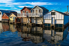 Boathouses on Candaigua Lake (pa_cosgrove) Tags: canandaigua ny lake pier boathouses sunset sky water reflections sony a73