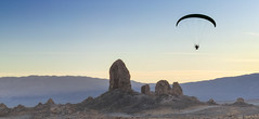 Flying (magnetic_red) Tags: paraglider flying tufas tronapinnacles sunrise landscape extremeterrain