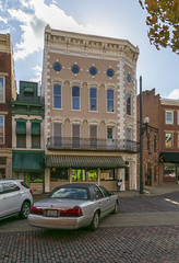 Building — Maysville, Kentucky (Pythaglio) Tags: building structure historic commercial fourstory brick ornate eclectic italianate quoins 11windows segmentalarched hoodmolds cars street sidewalk clouds cornice brackets keystones