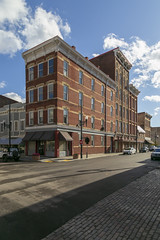 Building — Maysville, Kentucky (Pythaglio) Tags: building structure historic commercial fourstory brick italianate ornate 11windows threebay stringcourses incised carvings cornice brackets clouds sidewalk street shadows maysville kentucky masoncounty