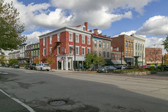 Buildings — Maysville, Kentucky (Pythaglio) Tags: buildings structures historic commercial threestory brick chimneys steppedgables storefronts sidewalk street cars clouds trees maysville kentucky masoncounty 11windows stone lintels sills friezeboard
