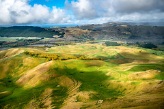 Panoramic rural agricultural farming view of the valley in Tuki Tuki below Te Mata Peak (stewart.watsonnz) Tags: landscape outdoors scenery nature mountain sky grass countryside hill noperson travel field valley grassland plant water painting summer land plateau fairweather scenic vegetation rock aerialview sunset yard dawn savanna road panoramic mountainrange path walkway pasture farm meadow ranch rural wilderness golfcourse promontory mound house cloud ground