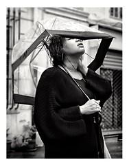 Le ciel est gris la pluie s'invite comme par surprise Elle est chez nous et comme un rite qui nous enlise les parapluies s'ouvrent en cadence comme une danse les gouttes tombent en abondance sur douce France. (streetspirit13) Tags: rainingday streetphotographer streetportrait streetpassionaward candidstreetphotography bw blackandwhite bnwdemands noiretblanc umbrella bnwstreetphoto