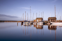 Harbour Reflections (Bernd Schunack) Tags: small harbour gager le long exposure nd filter sunset fantastic light old sailing boats ships nature rügen mönchgut reflection mirror port reed baltic sea water jetty masts pole lumix panasonic gx9 germany
