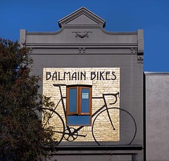 There's Gold Behind our Bicycles (l plater) Tags: balmainbikes sydney airlitewindows goldenwall
