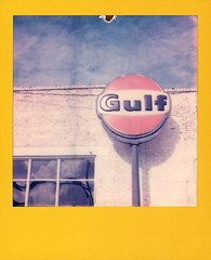 Gulf Sign (tobysx70) Tags: polaroid originals color film for 600 type cameras frames edition expired yellow slr680 roidweek roid week polaroidweek fall autumn october 2019 gulf sign station motors north locust street denton texas tx petrol gasoline gas oil company brick wall window reflection blue sky clouds divot polacon4 polacon2019 polacon 092819 day4 toby hancock photography