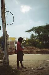 Poor guy. (Jerry501) Tags: expired nikonf4 85mm kodakfarbwelt100 india travel roadtrip analog film street