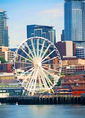 Moons and Junes and Ferris wheels the dizzy dancing way you feel As every fairy tale comes real I've looked at love that way. ~~Joni Mitchell (Irene2727) Tags: seattle city port ferriswheel buildings architecture water blue