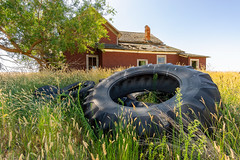 Spares In the Backyard (PNW-Photography) Tags: home homestead house farm farming farmer farmhouse country rural field brick tires tire rurex urbex old olden sunny abandoned rusty dusty rust dust derelict decay