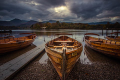 Boats on Lake Windermere (mandyhedley) Tags: lakedistricrydalwater windermere boats canoes rowingboats wooden lake lakedistrict moodysky evening landscape waterscape flickrtravelaward bownessonwindermere southlakelanddistrict england flickrexploreme