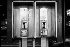 LeicaM6SummaritNYCPayphones (Johnny Martyr) Tags: telephone telephones payphone payphones two 2 double repeat repetition music dual dos communication telecommunication analog obsolete cell phone coinop coin op nyc new york city grain grainy film 35mm leica leitz m6 summarit 50mm talk talking speak speaking language electronic electronics public metal night light rangefinder street shine blackandwhite bw lines math composition vintagestyle vintage style