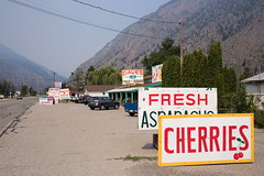 Keremeos - Fruit Stands (Vic Gedris) Tags: keremeos bc britishcolumbia canada similkameen smoke haze sign crowsnest crowsnesthighway fruit produce store cherries asparagus