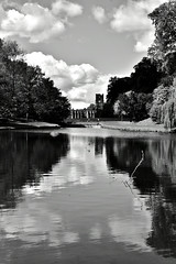 Fountains Abbey. (Hidden in the flash.) Tags: blackandwhite bw mono monochrome nikon d3400 nikkor nikond3400 yorkshire england uk unitedkindom landscape countryside lake water reflection ruin abbey clouds trees nt nationaltrust