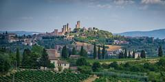 San Giminiano (markusgeisse) Tags: tuscany toskana skyline altstadt old town panorama italien italy zypressen wolken clouds hügel hills sony alpha green grün san giminiano