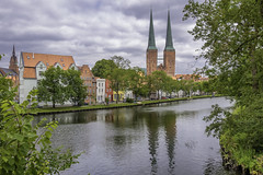 Hanseatic City Of Luebeck (dietmar-schwanitz) Tags: lübeck luebeck hansestadtlübeck hanseaticcityofluebeck schleswigholstein germany deutschland norddeutschland northerngermany hansestadt hanseaticcity hanse hanseaticleague city stadt altstadt oldtown trave rivertrave river fluss wasser water häuser houses wolken clouds himmel sky dom cathedral architektur architekture kirche church reise travel trip reisefotografie travelphotography urlaub vacation spiegelung reflections tourismus sehenswürdigkeit sight gebäude bauwerk building nikon nikond750 nikonafsnikkor24120mmf40ged flickr lightroom nikcollection colorefex dietmarschwanitz
