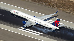 Delta 757-300. (spencer_wilmot) Tags: dl dal delta deltaairlines la lax klax losangeles boeing 757 b757 757300 b753 heavy arrival landing touchdown smoke ramp runway winglets twin plane passengerjet civilaviation commercialaviation boeing757 jet jetliner usa california aviation aircraft airplane airliner airport apron airside approach