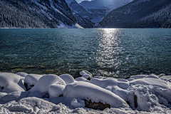 Lake Louise  Sunny and Cold (Postcards A La Carte) Tags: geocountry exif:lens=160800mmf2840 exif:isospeed=100 camera:make=nikon camera:model=nikond7500 exif:focallength=16mm exif:aperture=ƒ35 geolocation geostate geocity exif:model=nikond7500 exif:make=nikon postcardsfromtexas gaylonyancy nature landscape water green red orange backroadsoftexas texas colorado california portland naturephotographs redrose flower naturephotographer landscapephotographer topaz austintexas outside outdoors flora blue sky bluesky beach sunset sunrise river photographer newmexico arizona idaho utah redrocks monumentvalley nationalparks nikon7500