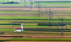 Sveta Ursula from a distance,  Slovenia. (AdelheidS Photography) Tags: adelheidsphotography adelheidsmitt adelheidspictures slovenia kranj svursula church farmland powerlines lonely telephoto distant
