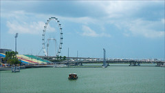 Water Taxi (meniscuslens) Tags: singapore bay marina wheel boat flier flyer sky clouds bridge
