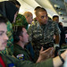 Royal Brunei Armed Forces discuss aircraft capabilities with U.S. Sailors inside a P-8 Poseidon