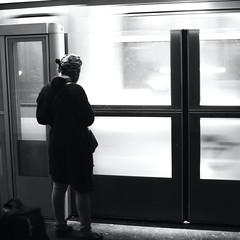 In front of screens (pascalcolin1) Tags: paris femme woman train métro subway lumière light écrans screens mouvement mooving photoderue streetview urbanarte noiretblanc blackandwhite photopascalcolin 50mm canon50mm