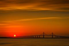 Sun rising over the Sunshine Skyway Bridge, St. Petersburg, Florida (diana_robinson) Tags: sunrise sunshineskywaybridge landscapescenery stpetersburg outdoors florida saintpetersburg cloudsky beautyinnature nikonflickraward abigfave