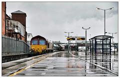 A spot o' weather (david.hayes77) Tags: nottingham eastmidlands shed class66 dbcargo 66079 66206 rhtt railheadtreatmenttrain 3j89 rain downpour reflections shower sonydscrx100m3 greyday dull autumnal autumn 2019 water puddles wetwetwet