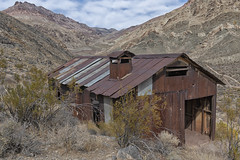 Leadfield (magnetic_red) Tags: ghosttown deathvalley leadfield building abandoned decay desert mountains tin rust rusted sky clouds tituscanyon