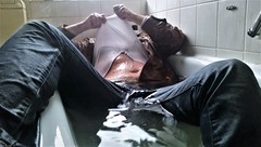 wet hunk (marcostetter) Tags: wetlook wet wetclothes wetclothing fullyclothed wetshirt bathtub jeans bluejeans leather selfie unusual