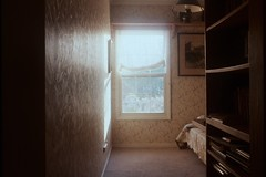 Reading spot (blottatomy) Tags: books goldenhour reading spot nikonf4 analogue film kodak200