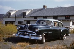 Mom takes a spin in dad's new 1953 Pontiac Chieftan in the weedy parking lot of an old restaurant somewhere in Connecticut. Love those wide whitewall tires, the enormous amount of chrome and painted hub caps. October 1954 (wavz13) Tags: analog vintageanalog 1950sanalog oldphotographs oldphotos 1950sphotographs 1950sphotos oldphotography 1950sphotography vintagesnapshots oldsnapshots vintagephotographs vintagephotos vintagephotography filmphotos filmphotography carphotography carphotos automotivephotography oldpontiacs vintagepontiacs 1950spontiacs antiquepontiacs oldcars vintagecars 1950scars collectiblecars collectablecars antiquecars vintagegeneralmotors oldgeneralmotors antiquegeneralmotors oldrestaurants vintagerestaurants antiquerestaurants lunchcounters oldlunchcounters vintagelunchcounters antiquelunchcounters connecticutphotographs connecticutphotos connecticutphotography oldconnecticutphotography oldconnecticutphotos oldconnecticut vintageconnecticut vintagenewengland oldnewengland 1950snewengland vintagenewenglandphotography oldnewenglandphotography kodachrome oldslides vintageslides familyslides vintagekodachrome oldkodachrome oldfamilyslides vintagecar oldcar vintagefamilyphotos oldfamilyphotos 1950sfamilyphotos s