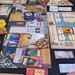 Museum Brettspiel ausgebreitet auf einem Tisch und von Messebesuchern gespielt