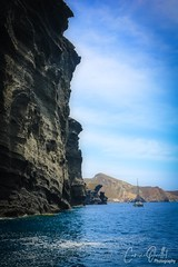 What an impressive view!!  Santorini island (corineouellet) Tags: spectacular nature landscape canonphoto santorini greece europe sailing view oceanview seaside seascape sea blueocean bluesky ocean mountain mountains rocher cliff island travel
