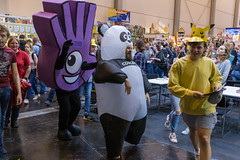 A mascot of the Dobble card game, a man in a panda costume and a girl in a Pokemon mask at the international gaming fair SPIEL '19 in Essen, Germany