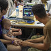 A Navy corpsman checks an infant's vital signs at a temporary medical treatment site in Santo Domingo.