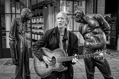 THE STREET MUSICIAN (NorbertPeter) Tags: man street people portrait city urban düsseldorf germany spontaneous sony rx100 music streetphotography streetportrait streetmusician guitar old monochrome blackandwhite bw statuary