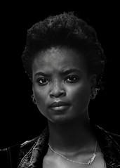 Portrait (D80_546728) (Itzick) Tags: manhattansep2019 nyc bw youngwoman blackbackground face facialexpression streetphotography portrait d800 itzick