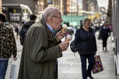 Two Scoops (Leanne Boulton) Tags: street portrait urban fun funny humorous candid profile streetphotography streetlife humour decisivemoment candidportrait candidstreetphotography old autumn food man cold male face weather tongue melting cone eating expression elderly icecream twoscoops hands detail texture bokeh depthoffield tone light outdoor naturallight shade life city people living humanity culture lifestyle scene human society uk colour canon scotland glasgow 70mm canon5dmkiii ef2470mmf28liiusm