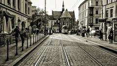 Old Town Krakow (rainerpetersen657) Tags: krakow krakau poland polska polen city travel houses tram sony sonyalpha street people sepia cracovia polonia